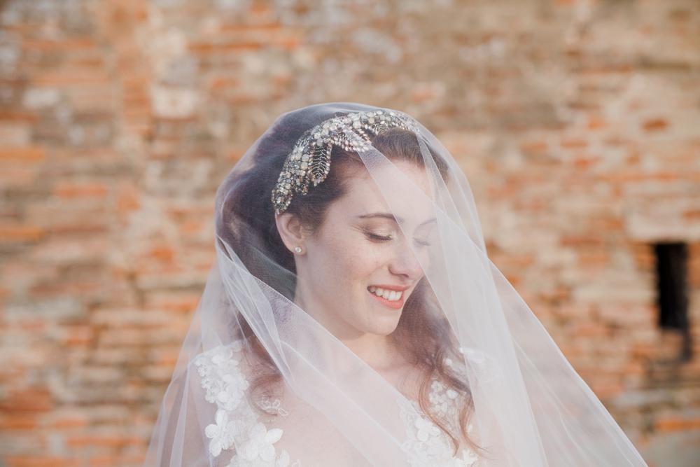 Igor Albanese Photography Smiling bride under veil