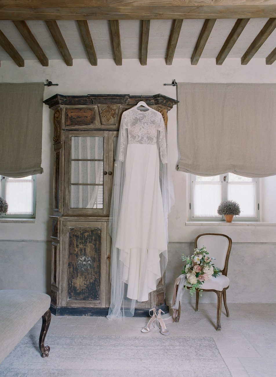 bridal suite at Borgo Santo Pietro wedding dress bouquet Corbin Gurkin Laura Bravi Events La Rosa Canina Firenze