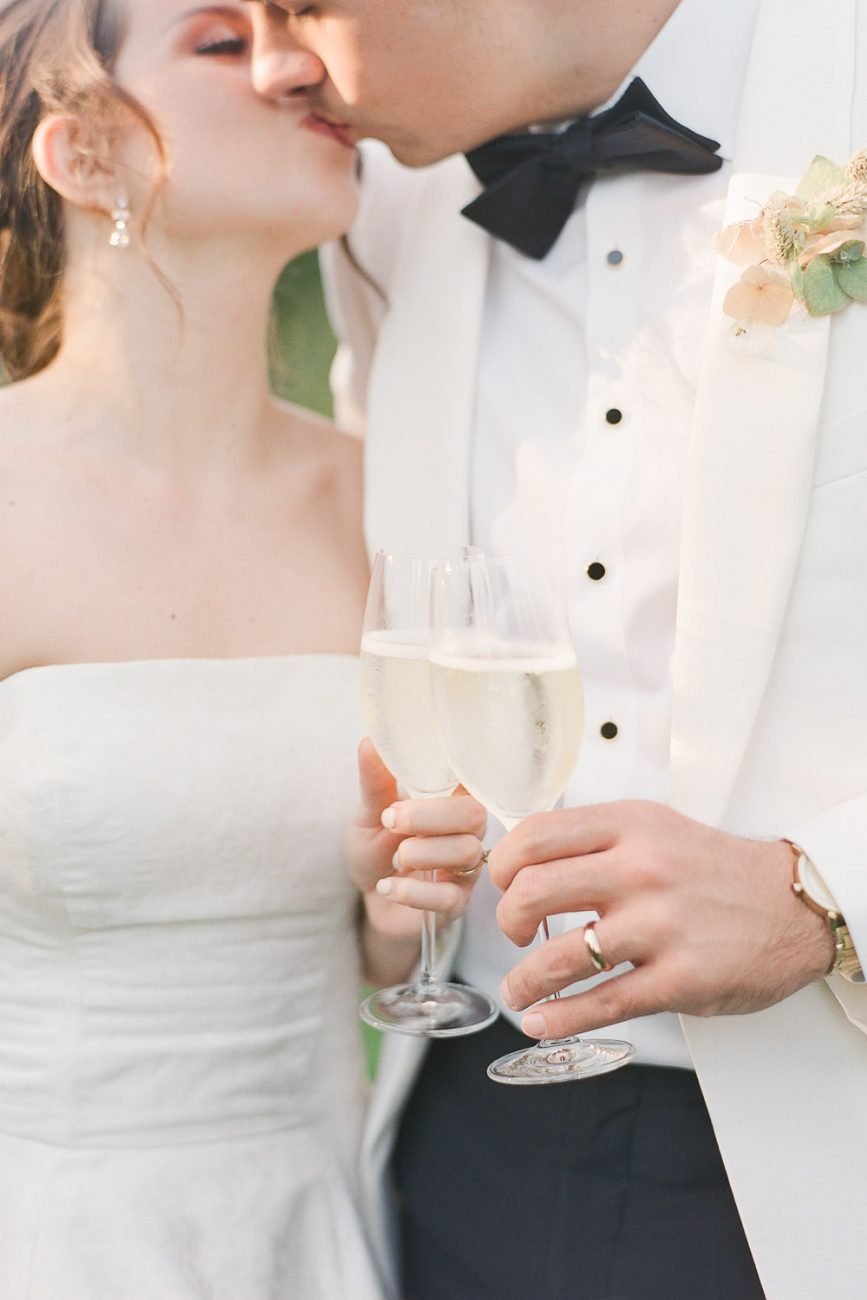 Fine art bride and groom toasting at Villa Cetinale - Molly Carr Photography