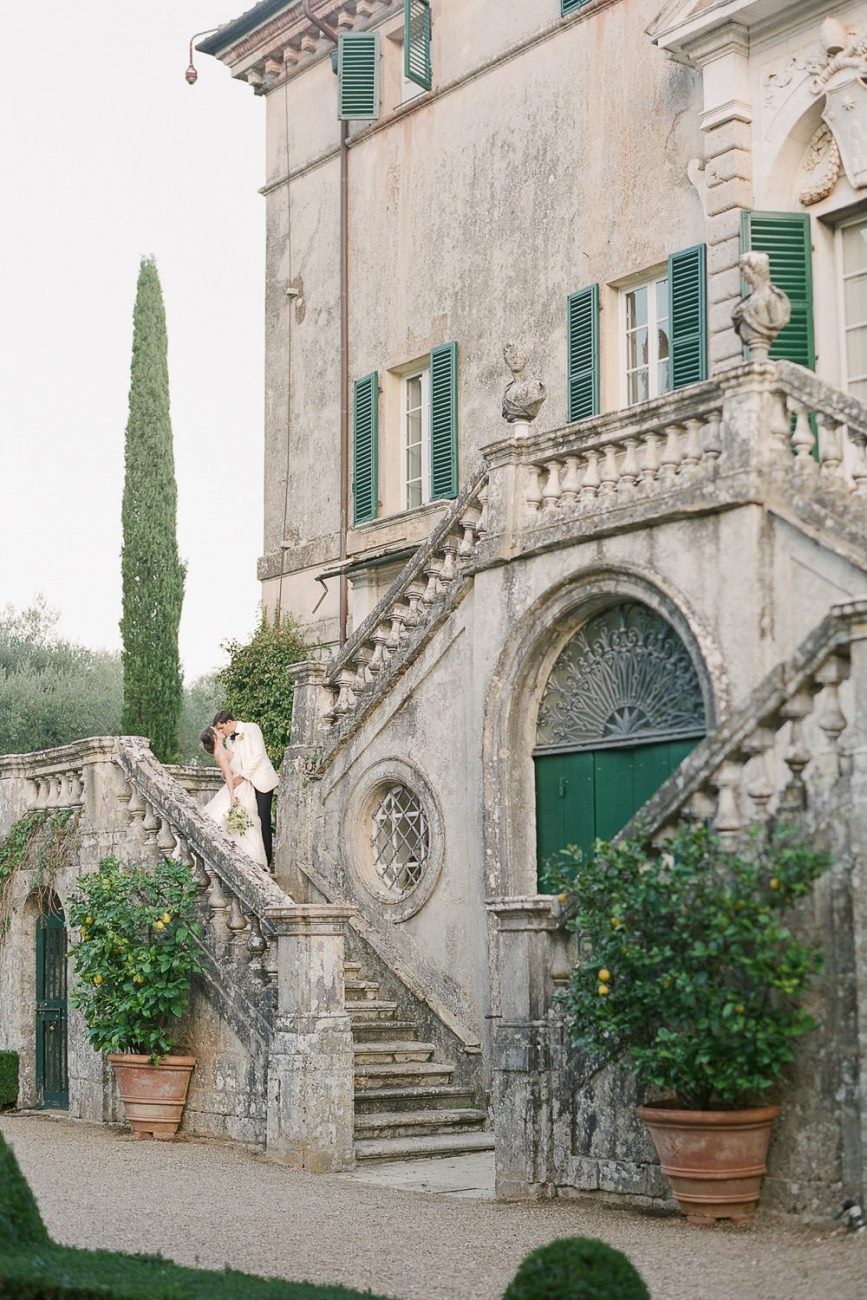 Molly Carr Photography Fine art bride and groom portrait on the steps of Villa Cetinale